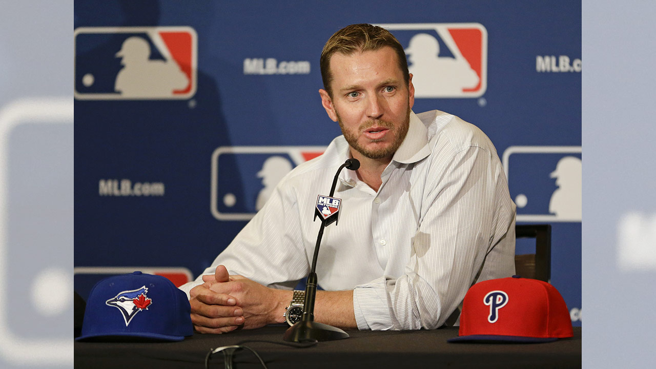 FILE - In this Dec. 9, 2013, file photo, two-time Cy Young Award winner Roy Halladay answers questions after announcing his retirement after 16 seasons.