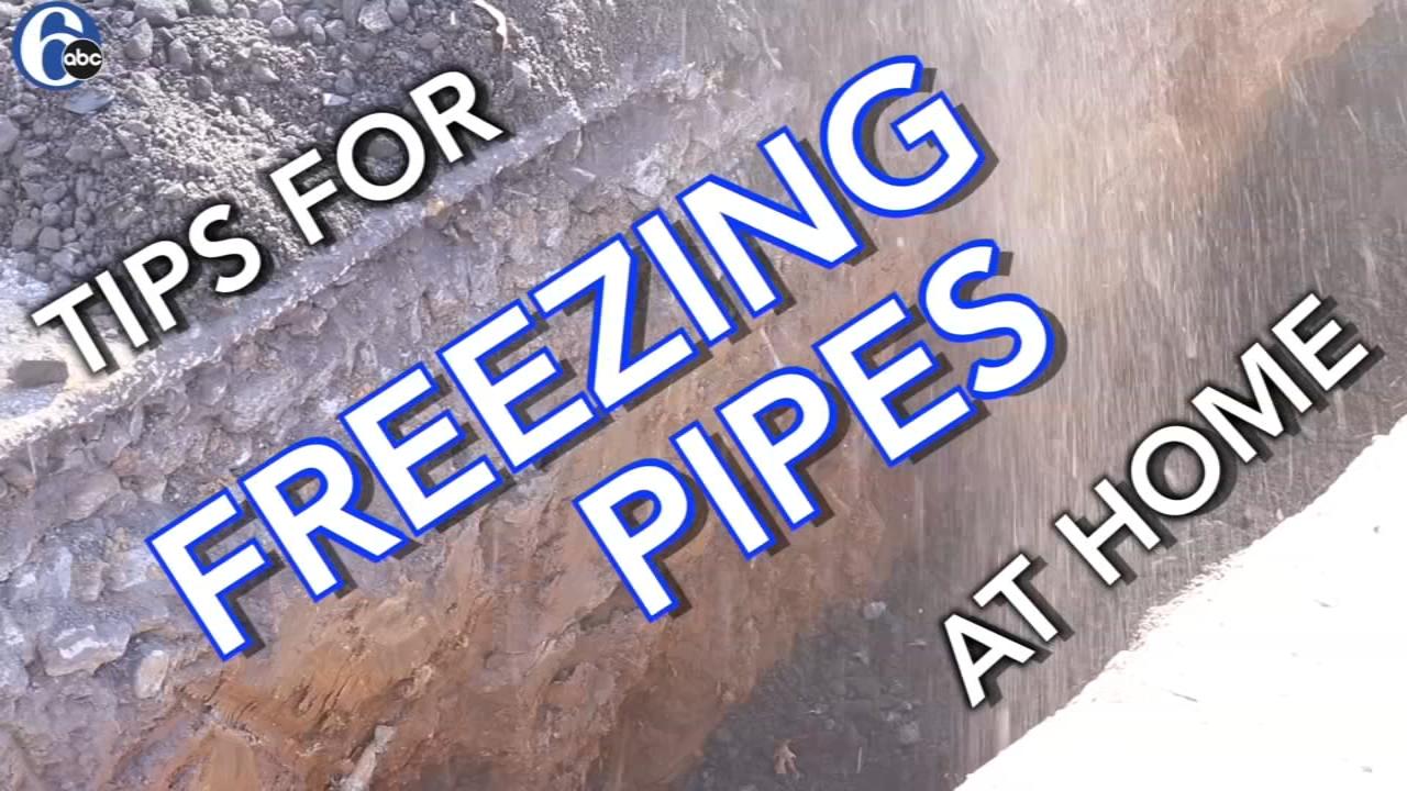 Water main repair team works through bitter cold.