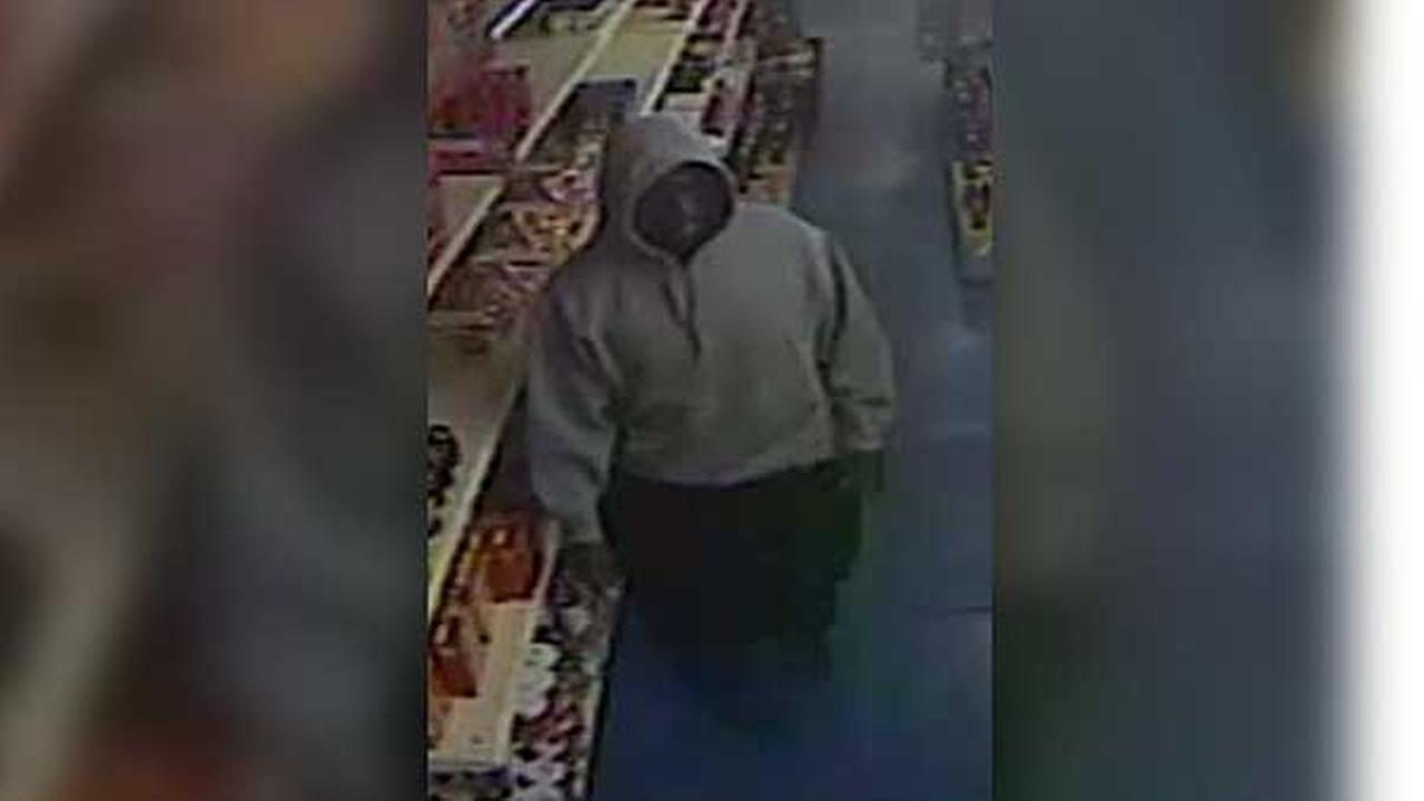 Police are looking for a suspect who robbed a South Philadelphia grocery store at gunpoint.
