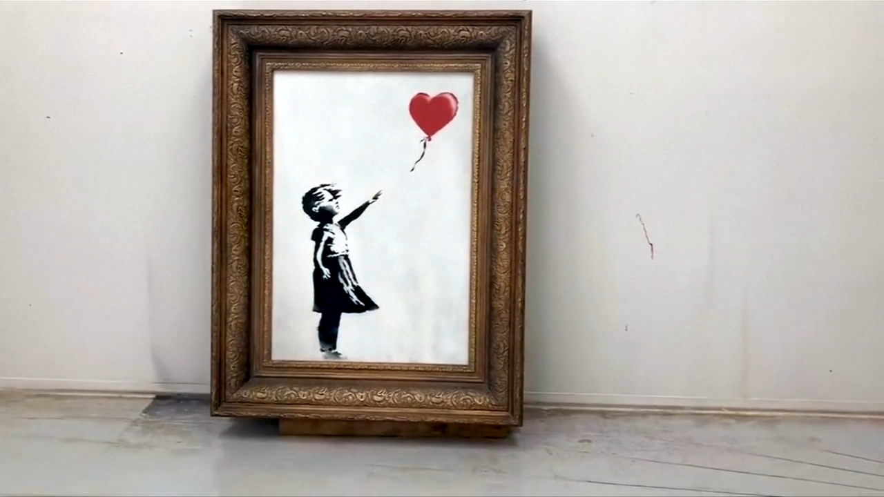 Banksy video shows shredding stunt did not go as planned.