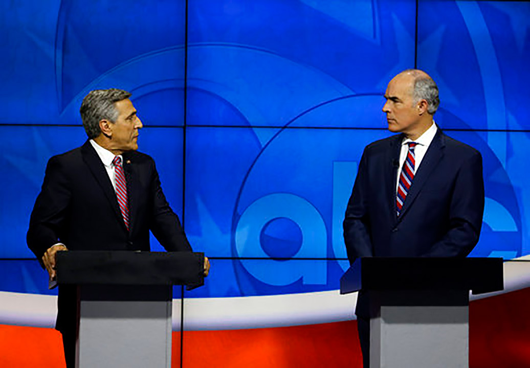 U.S. Sen.Bob Casey, D-PA, right, listens to Republican challenger U.S. Rep. Lou Barletta, during their first debate, Saturday Oct. 20, 2018, in the studio of WPVI-TV in Phila.