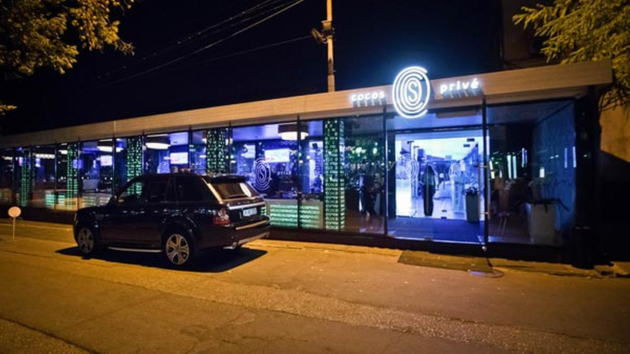 In this Oct. 5, 2015 photo, an imported luxury SUV is parked outside the Cocos Prive club in Chisinau, Moldova.