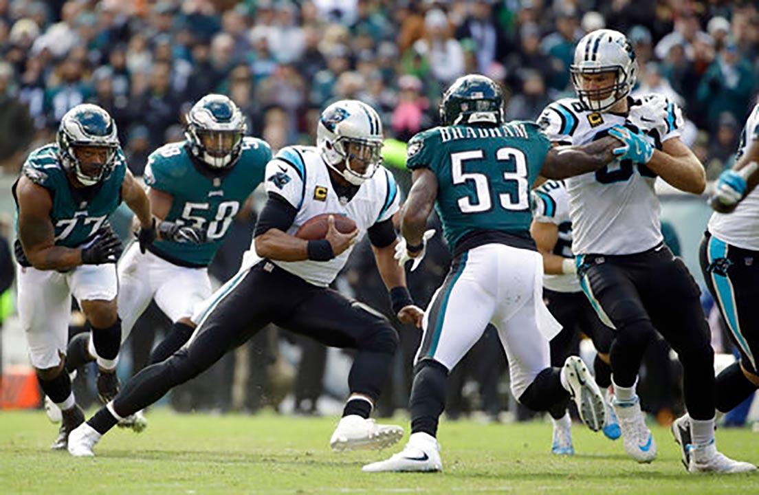 Carolina Panthers qb Cam Newton (1) scrambles as Philadelphia Eagles defensive end Michael Bennett (77), linebacker Jordan Hicks (58) and linebacker Nigel Bradham (53) defend.