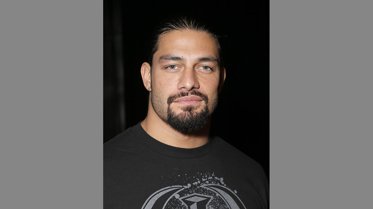 WWE Roman Reigns attends the WWE 2K15 SummerSlam Confidential Panel at Club Nokia, on Saturday, August 16, 2014 in Los Angeles.