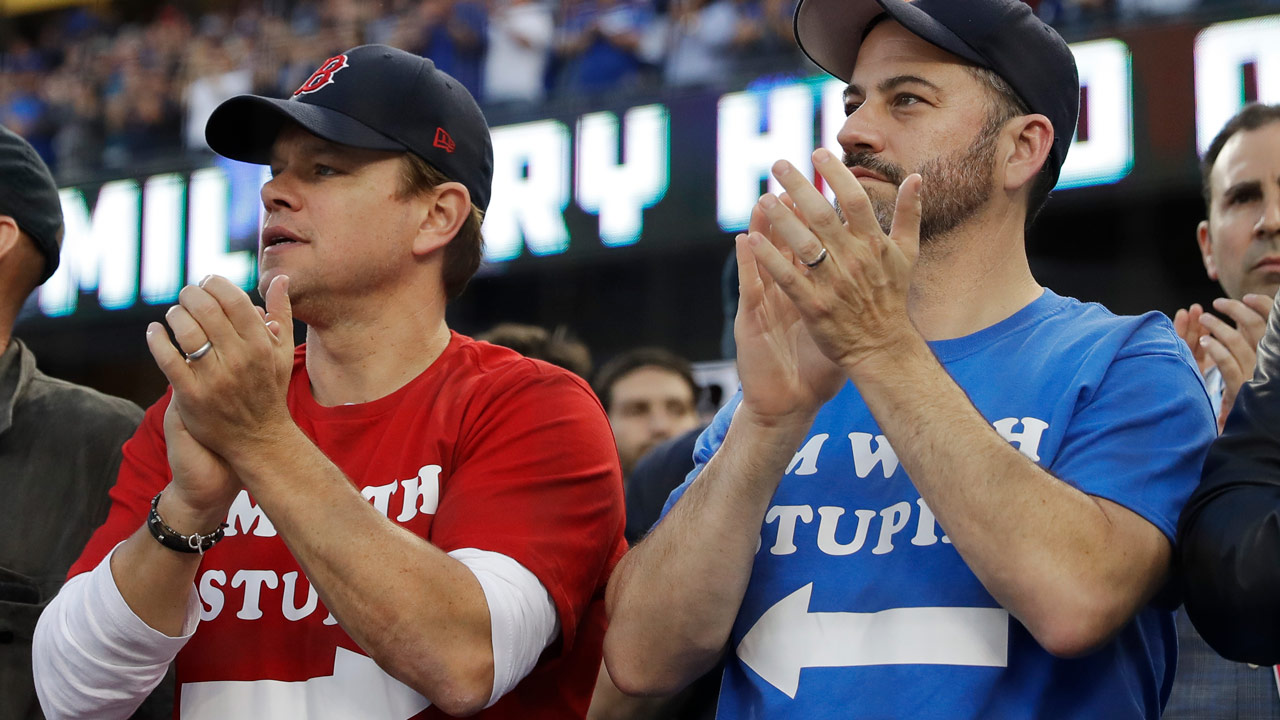 Actor Matt Damon and talk show host Jimmy Kimmel watch Game 5 of the World Series baseball game between the Boston Red Sox and Los Angeles Dodgers on Sunday, Oct. 28, 2018.
