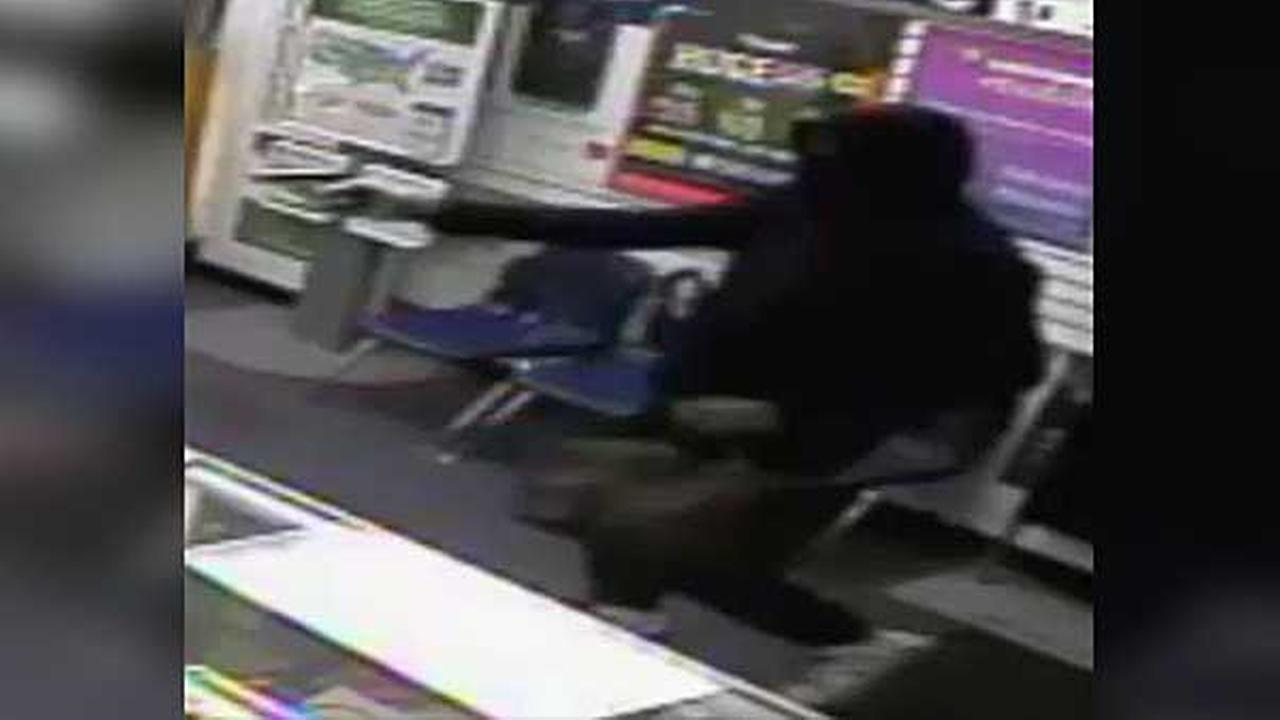 Philadelphia police are looking for a suspect who robbed a cell phone store at gunpoint in the citys Germantown section.