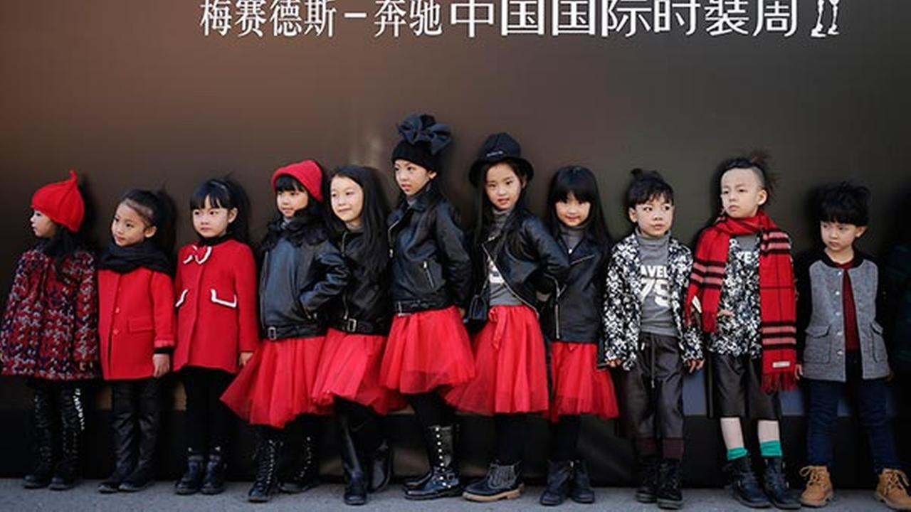 Models for the childrens wear fashion show stand outside the venue during the China Fashion Week in Beijing, Thursday, Oct. 29, 2015.