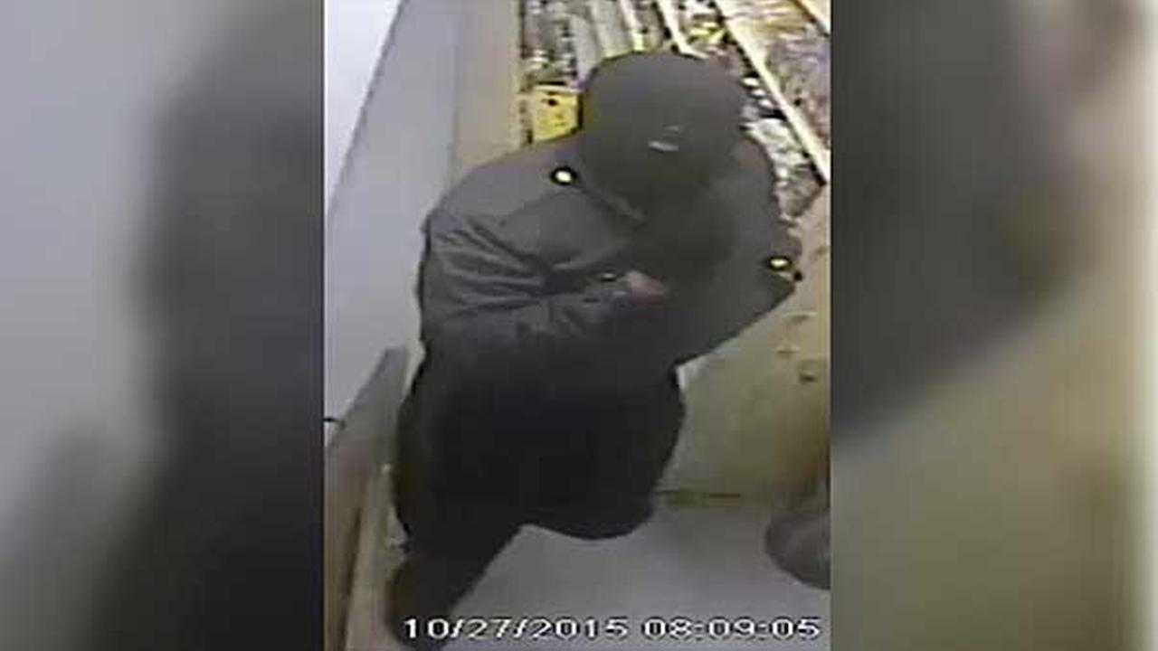 Police are looking for two masked men who robbed a grocery store with a sawed-off shotgun in North Philadelphia.