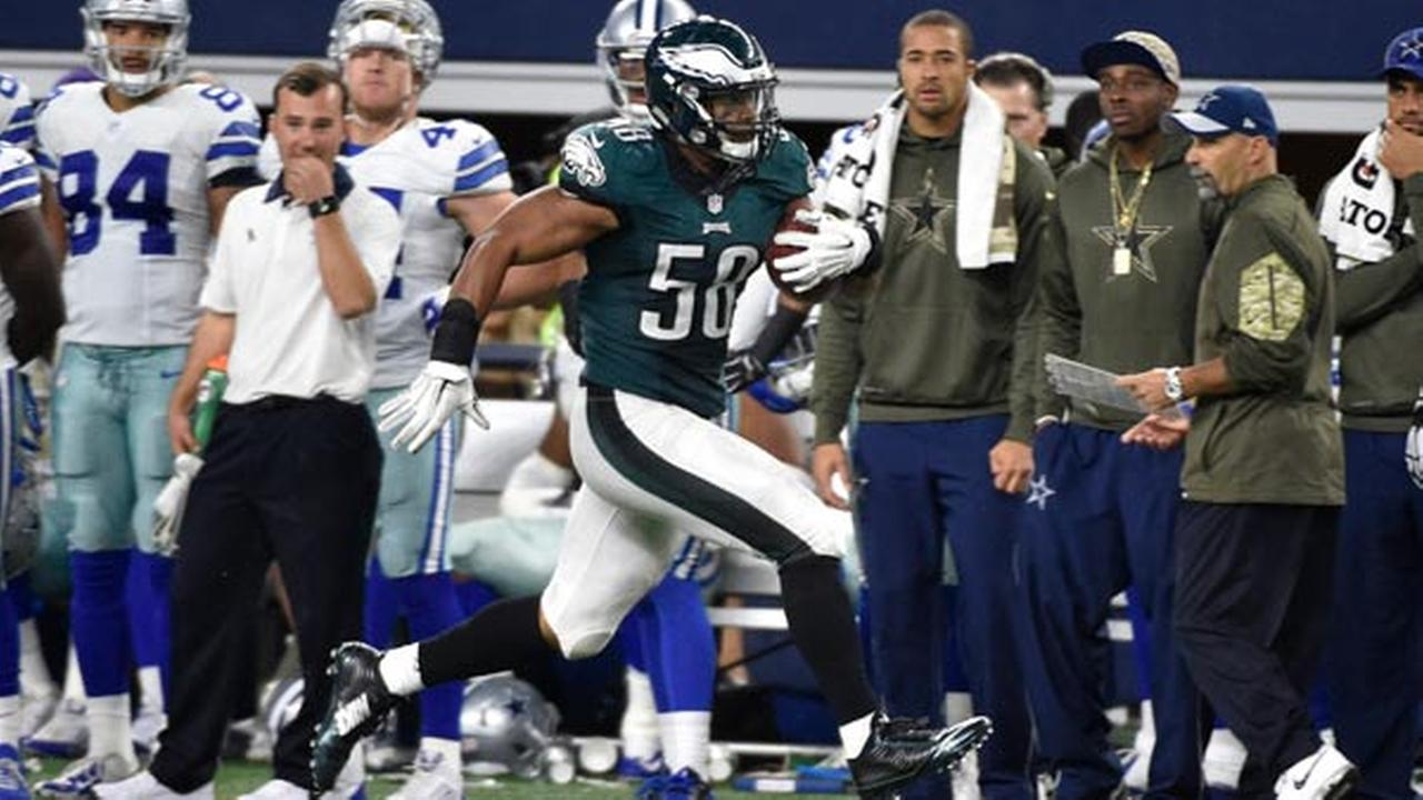 Philadelphia Eagles Jordan Hicks (58) runs back an interception from the Dallas Cowboys for a touchdown in the second half of an NFL football game, Sunday, Nov. 8, 2015.