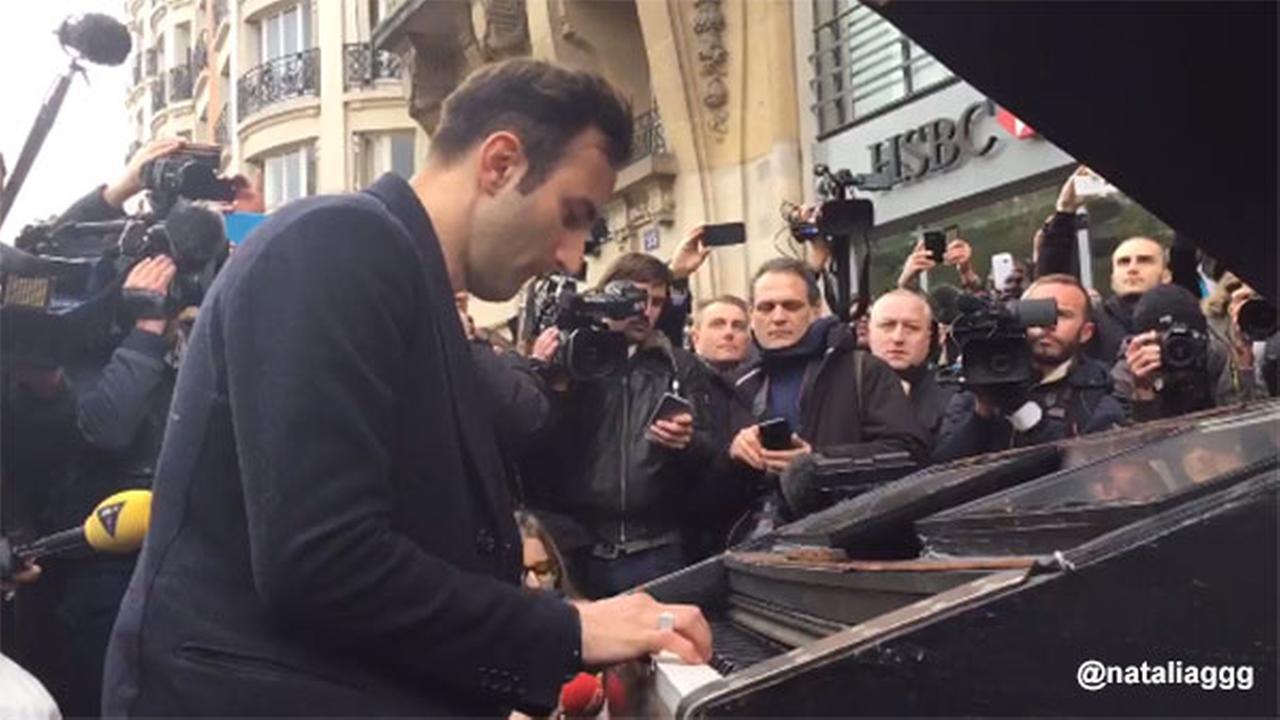 Mystery man plays 'Imagine' on piano near Paris concert hall