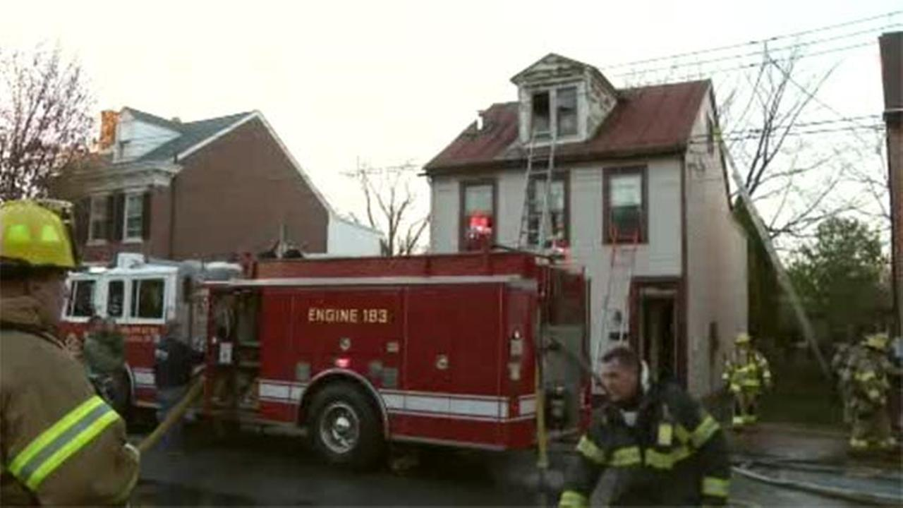 Delaware officials are investigating a three-story house fire in New Castle.