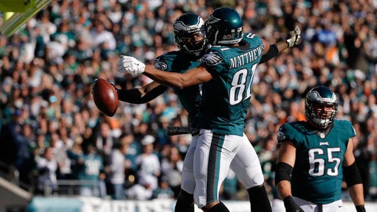 Philadelphia Eagles Josh Huff, left, and Jordan Matthews celebrate after Huffs touchdown during the first half of an NFL football game against the Miami Dolphins.