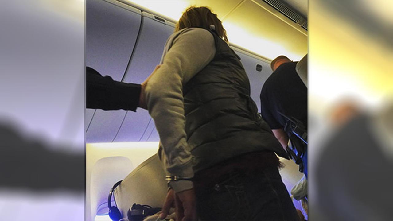 Cops: Drunk woman tried to open UK-to-Boston jet's exit door