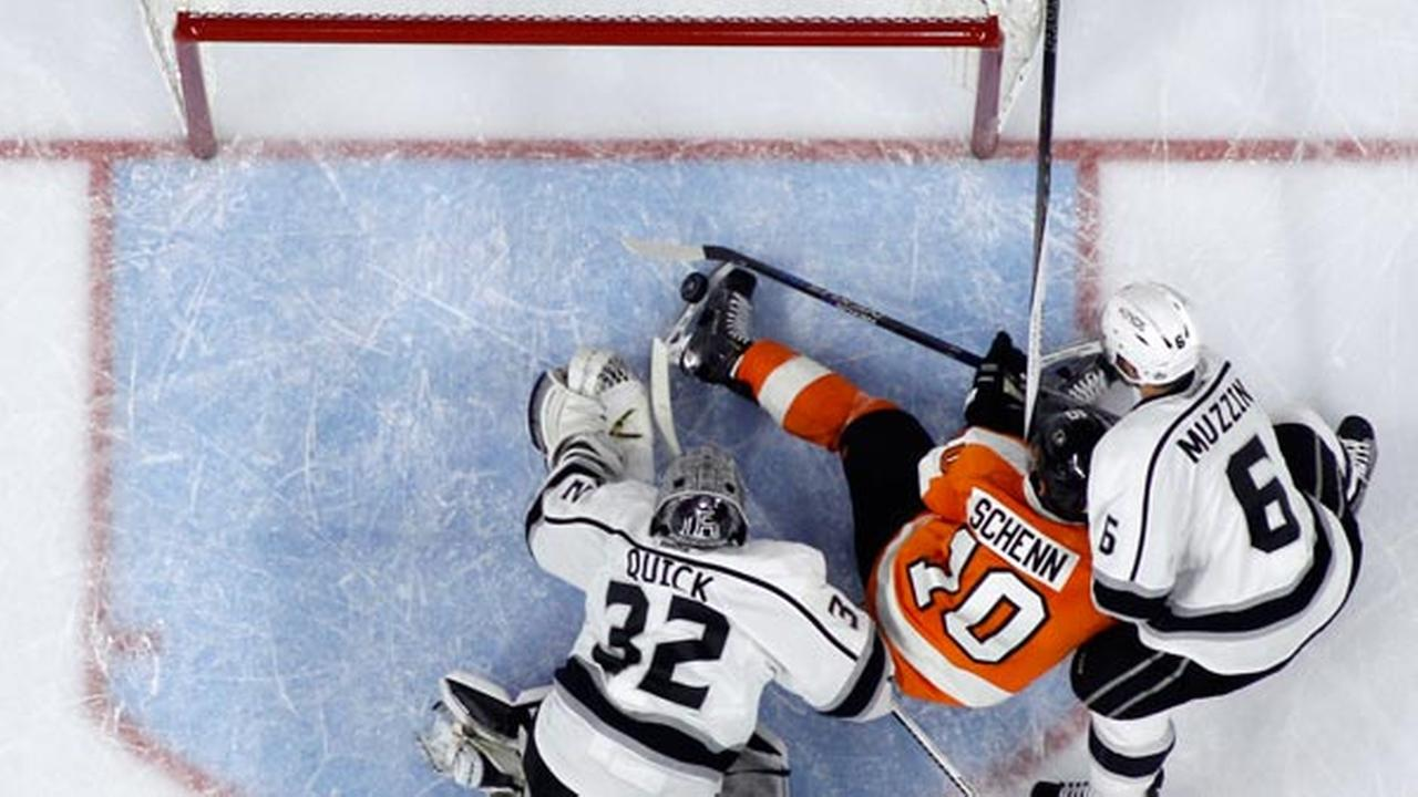 Philadelphia Flyers Brayden Schenn (10) kicks the puck into the net between Los Angeles Kings Jonathan Quick (32) and Jake Muzzin (6).