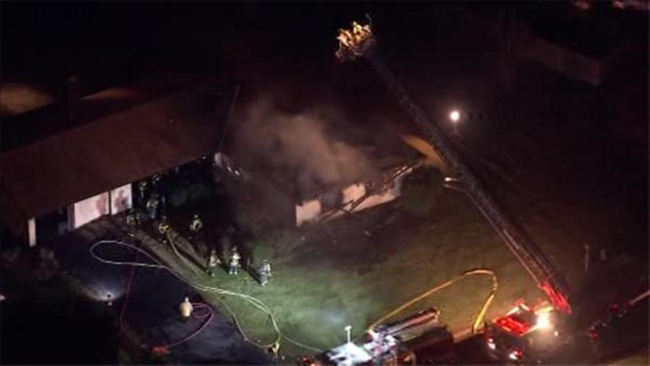 One person is hospitalized after a house fire broke out in Burlington County.