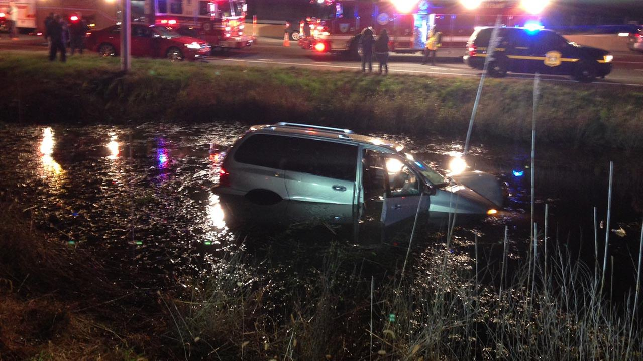 Delaware State Police are investigating a crash in which a van landed in a retention pond in Christiana.