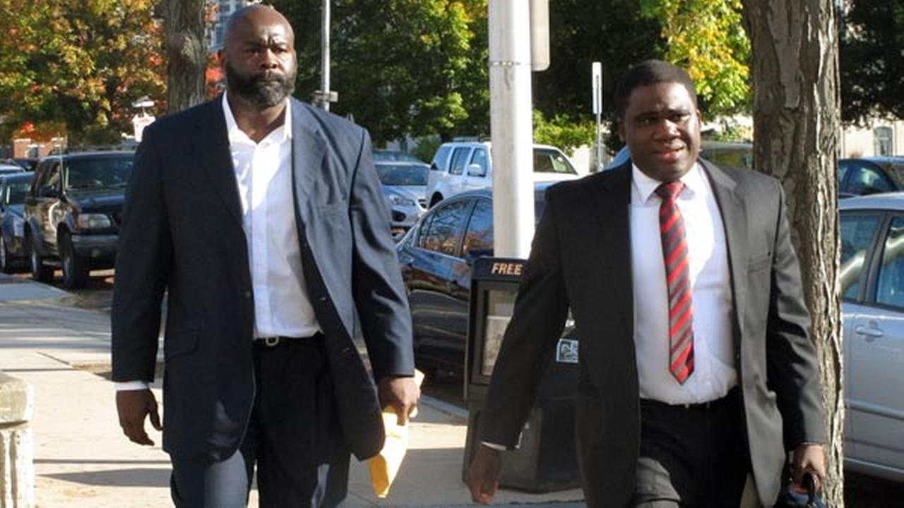 FILE: Former NFL defense end Hugh Douglas, left, walks with his lawyer, Corey Brinson, to Hartford Superior Court, Monday, Oct. 21, 2013, in Hartford, Conn.