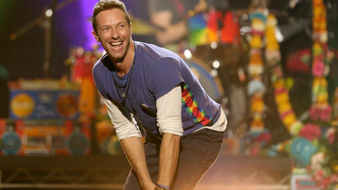 Chris Martin of Coldplay performs at the American Music Awards at the Microsoft Theater on Sunday, Nov. 22, 2015, in Los Angeles.