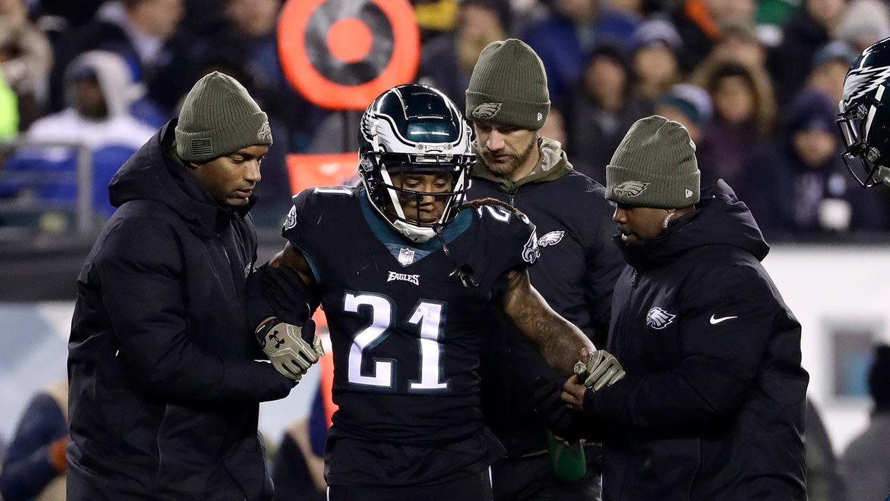 Philadelphia Eagles cornerback Ronald Darby (21) is helped off the field by trainers during the second half on Sunday, Nov. 11, 2018, in Philadelphia.