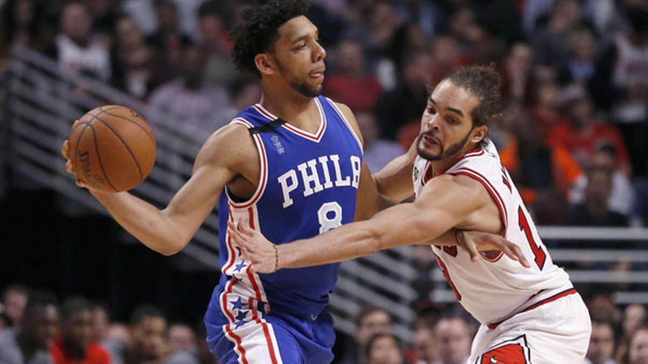 Chicago Bulls center Joakim Noah (13) pressures Philadelphia 76ers center Jahlil Okafor during the second half of an NBA basketball game Monday, Dec. 14, 2015, in Chicago.