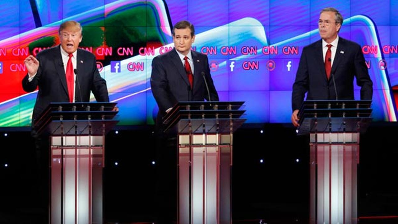 Donald Trump, left, speaks as Ted Cruz, center, and Jeb Bush look on during the CNN Republican presidential debate at the Venetian Hotel and Casino on Tuesday, Dec. 15, 2015, in Las
