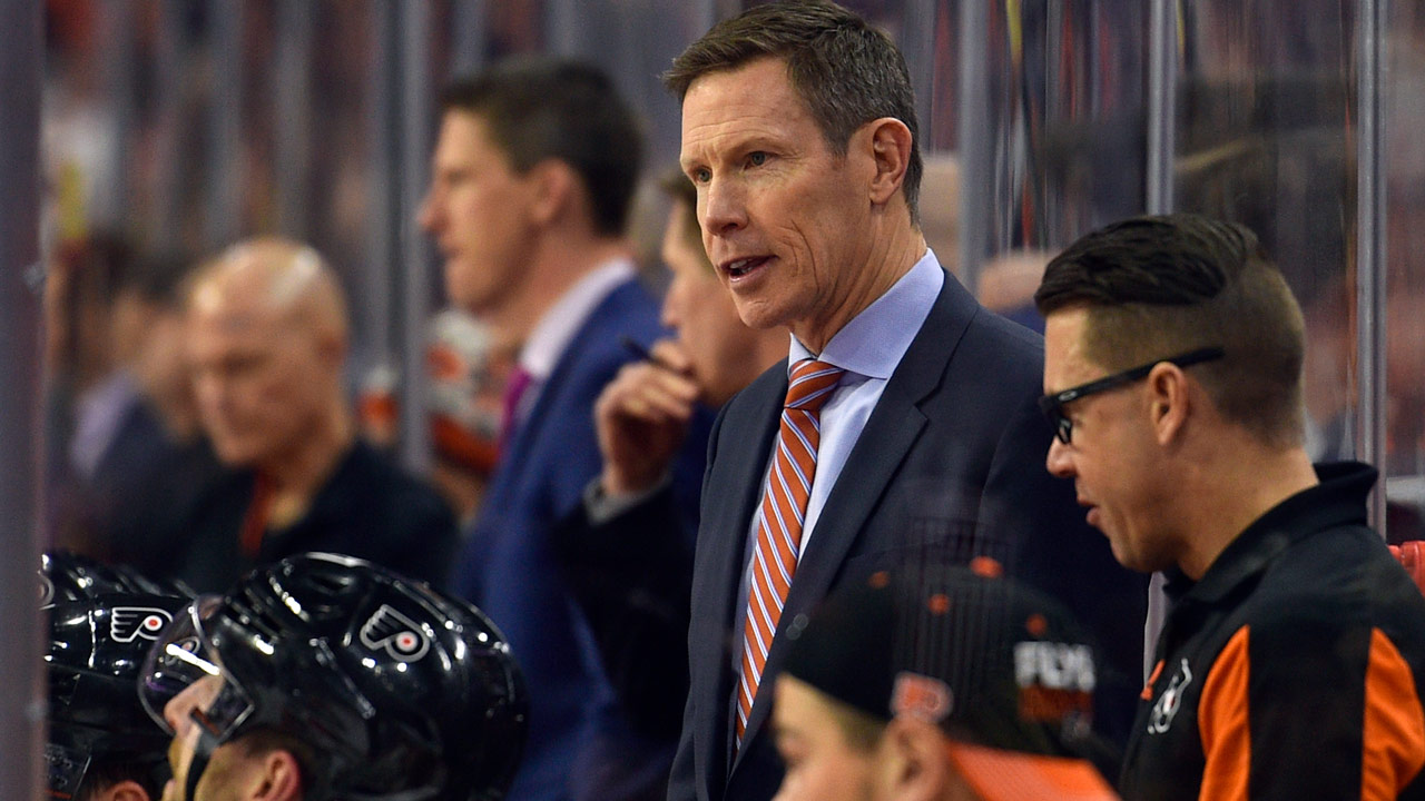 Philadelphia Flyers assistant coach Gord Murphy looks on from the bench during an NHL hockey game against the Boston Bruins, Saturday, Dec. 2, 2017, in Philadelphia.