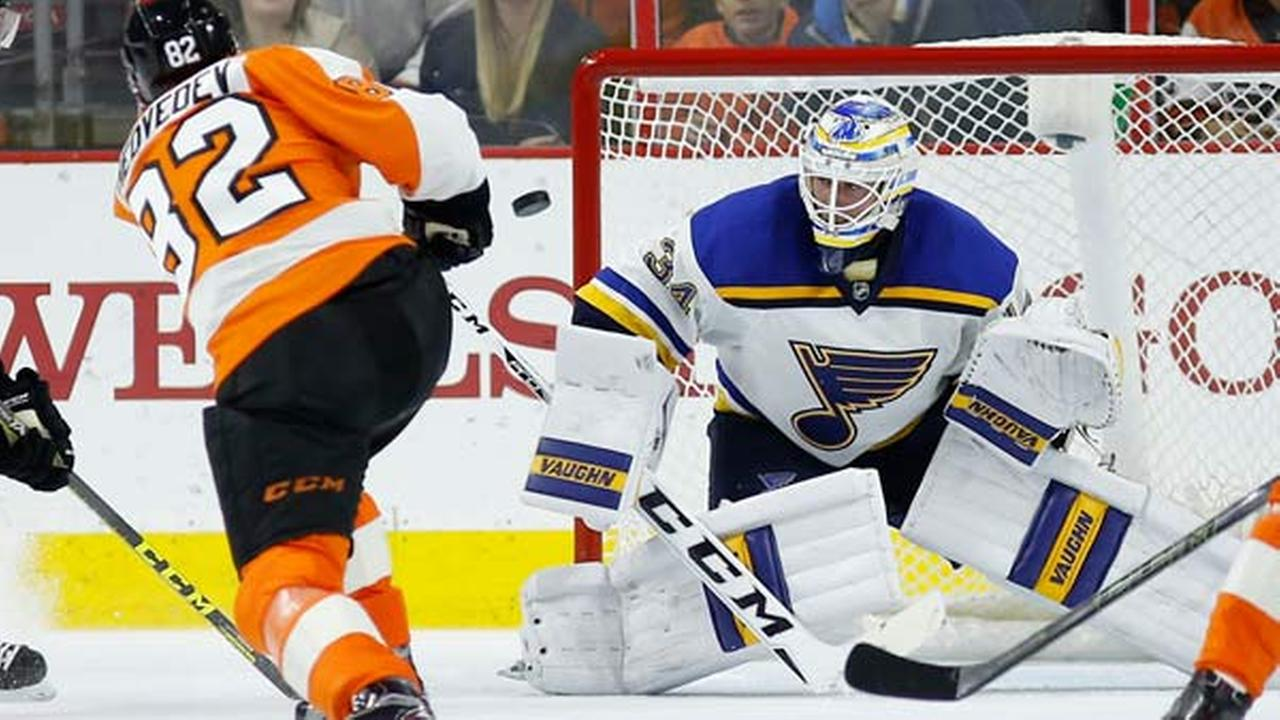 Philadelphia Flyers Evgeny Medvedev, left, scores the go-ahead goal against St. Louis Blues Jake Allen during the third period of an NHL hockey game, Monday, Dec. 21, 2015.