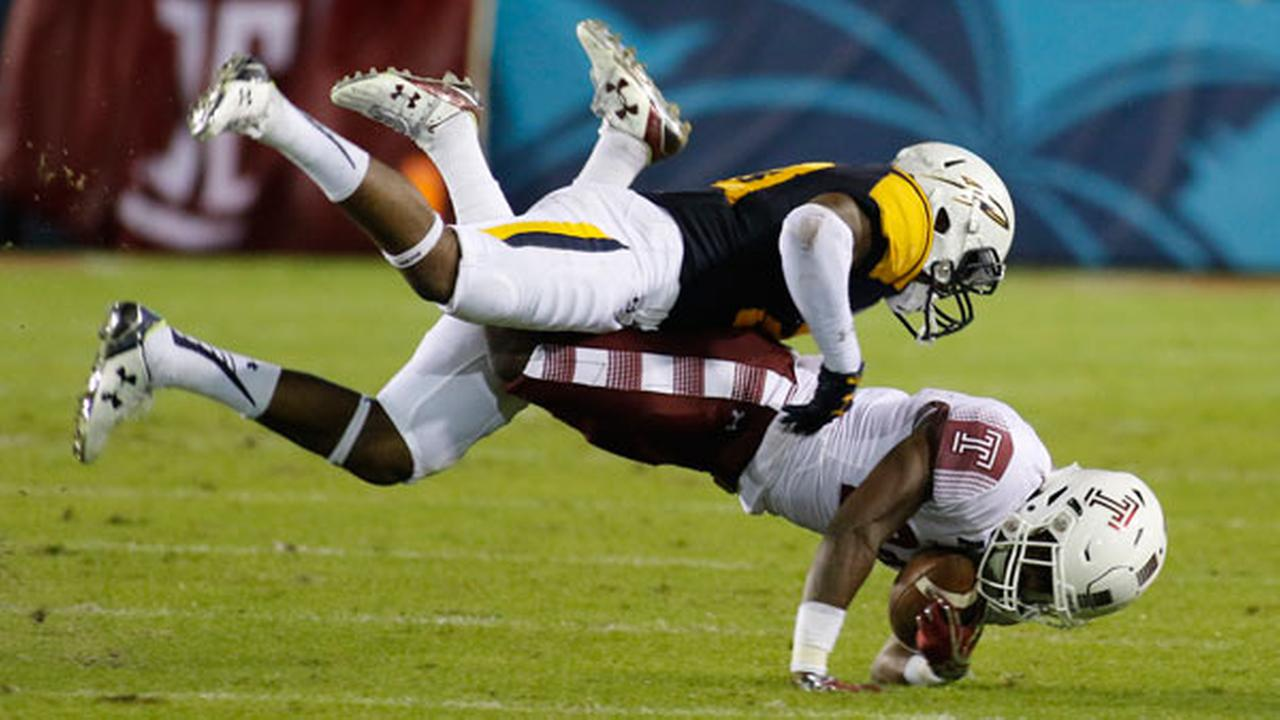 Temple running back Ryquell Armstead, below, is brought down by Toledo linebacker Josh High during the first quarter of the Boca Raton Bowl NCAA college football game.