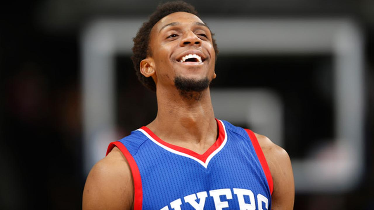 Philadelphia 76ers guard Ish Smith smiles as time runs out in the 76ers NBA basketball game against the Denver Nuggets on Wednesday, March 25, 2015, in Denver.