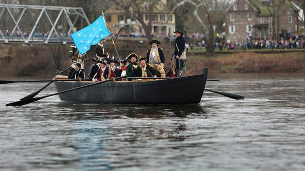 John Godzieba, standing second from right, portraying Gen. George Washington, looks towards New Jersey from a Durham boat during a re-enactment of Washingtons historic crossing.