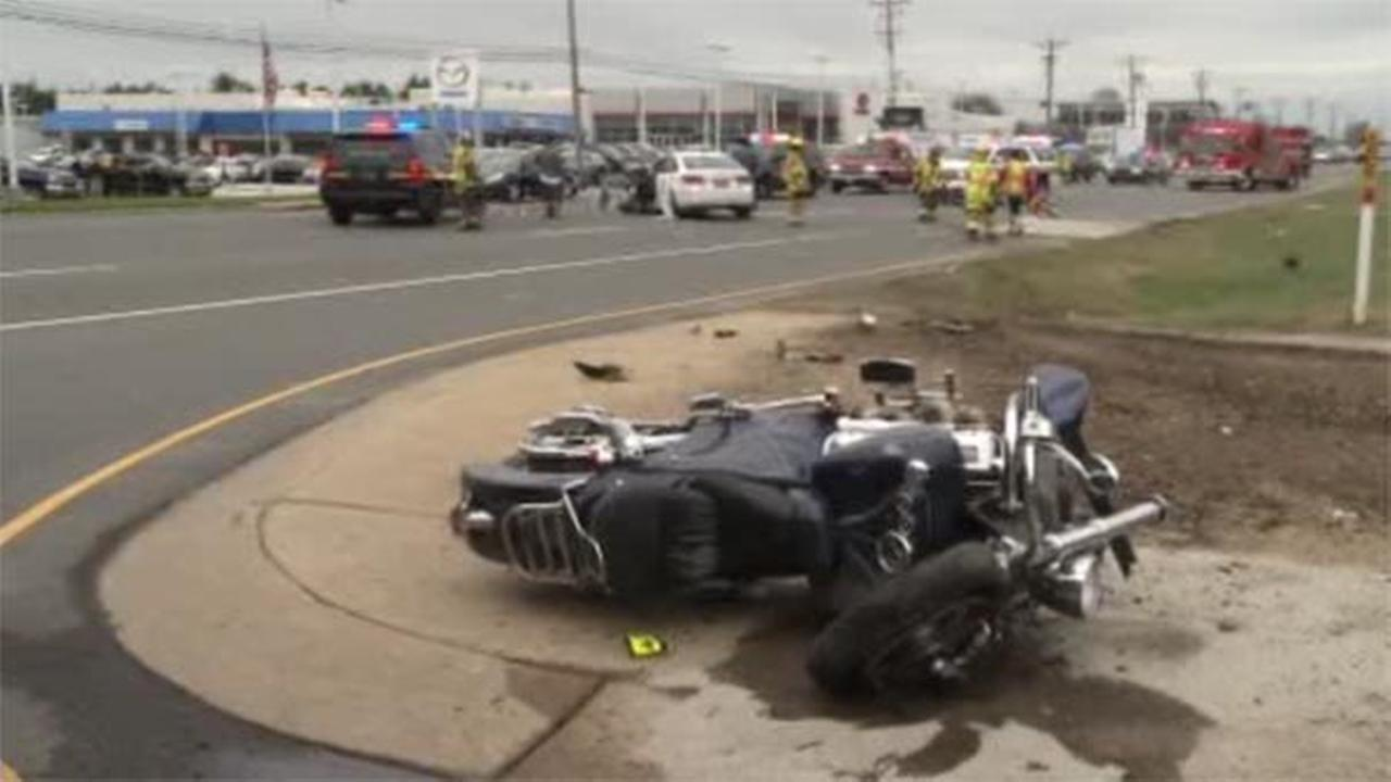 A 61-year-old man is hospitalized after a crash involving a motorcycle and sedan in New Castle.