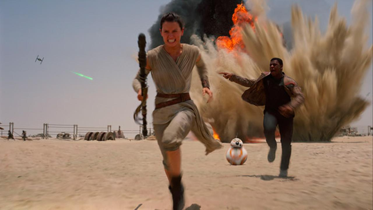 This photo provided by Disney shows Daisey Ridley as Rey, left, and John Boyega as Finn, in a scene from the new film, Star Wars: The Force Awakens.