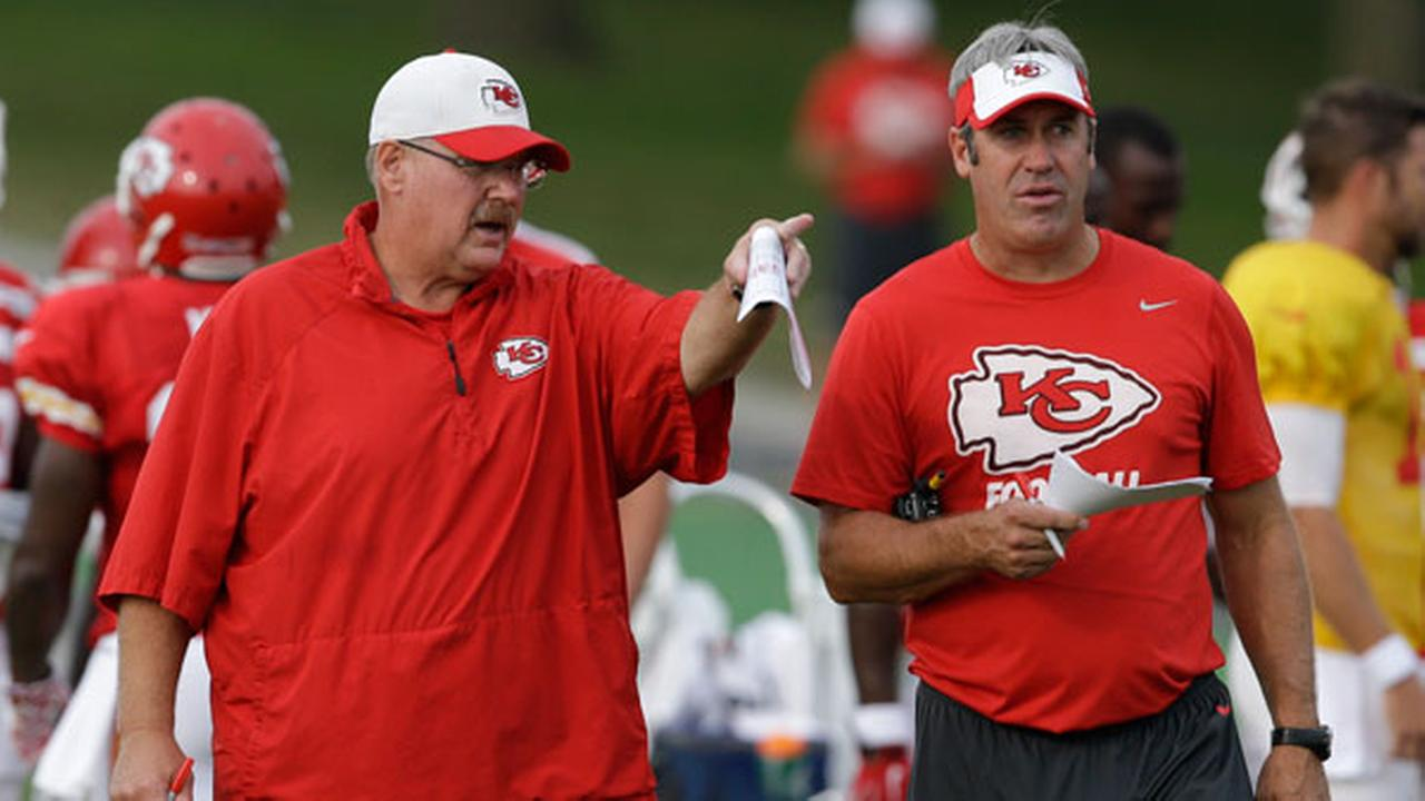 FILE - In this Aug. 17, 2015 file photo, Kansas City Chiefs head coach Andy Reid, left, and offensive coordinator Doug Pederson, right, talk during NFL football training camp.