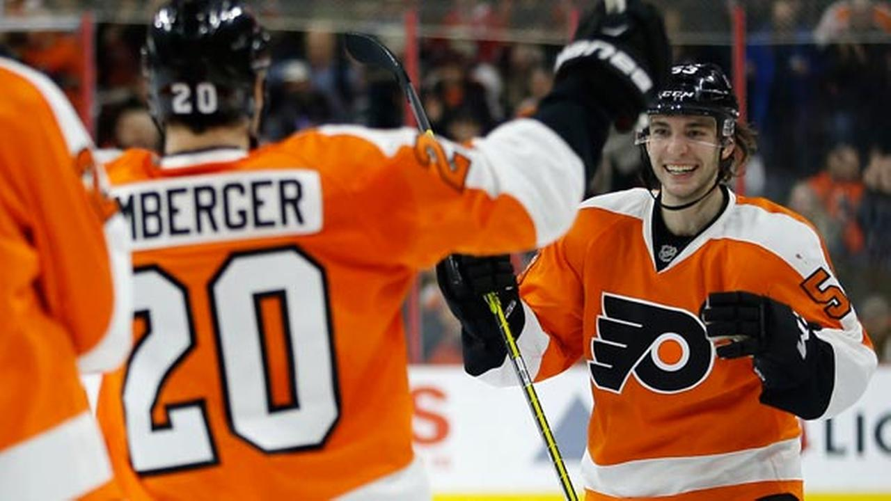 Philadelphia Flyers Shayne Gostisbehere, right, celebrates with R.J. Umberger after Gostisbeheres goal during the second period of an NHL game against the Montreal Canadiens.