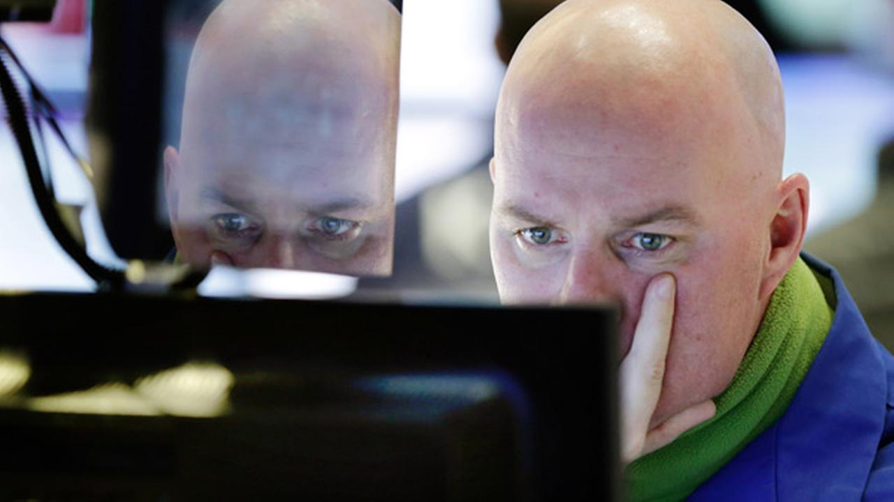Specialist John OHara works at his post on the floor of the New York Stock Exchange, Thursday, Jan. 7, 2016.