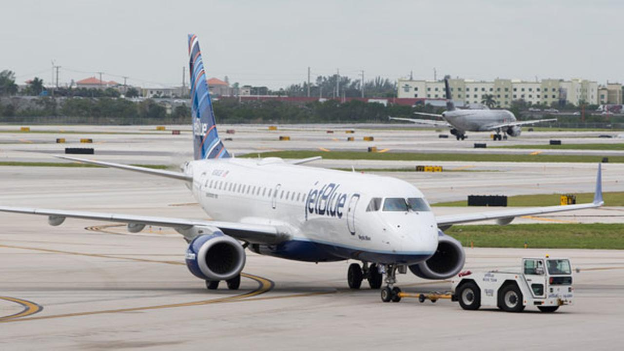 FILE: A JetBlue Embraer 190 passenger jet is towed to an arrival gate at the Fort Lauderdale-Hollywood International Airport, Friday, Dec. 18, 2015, in Fort Lauderdale, Fla.