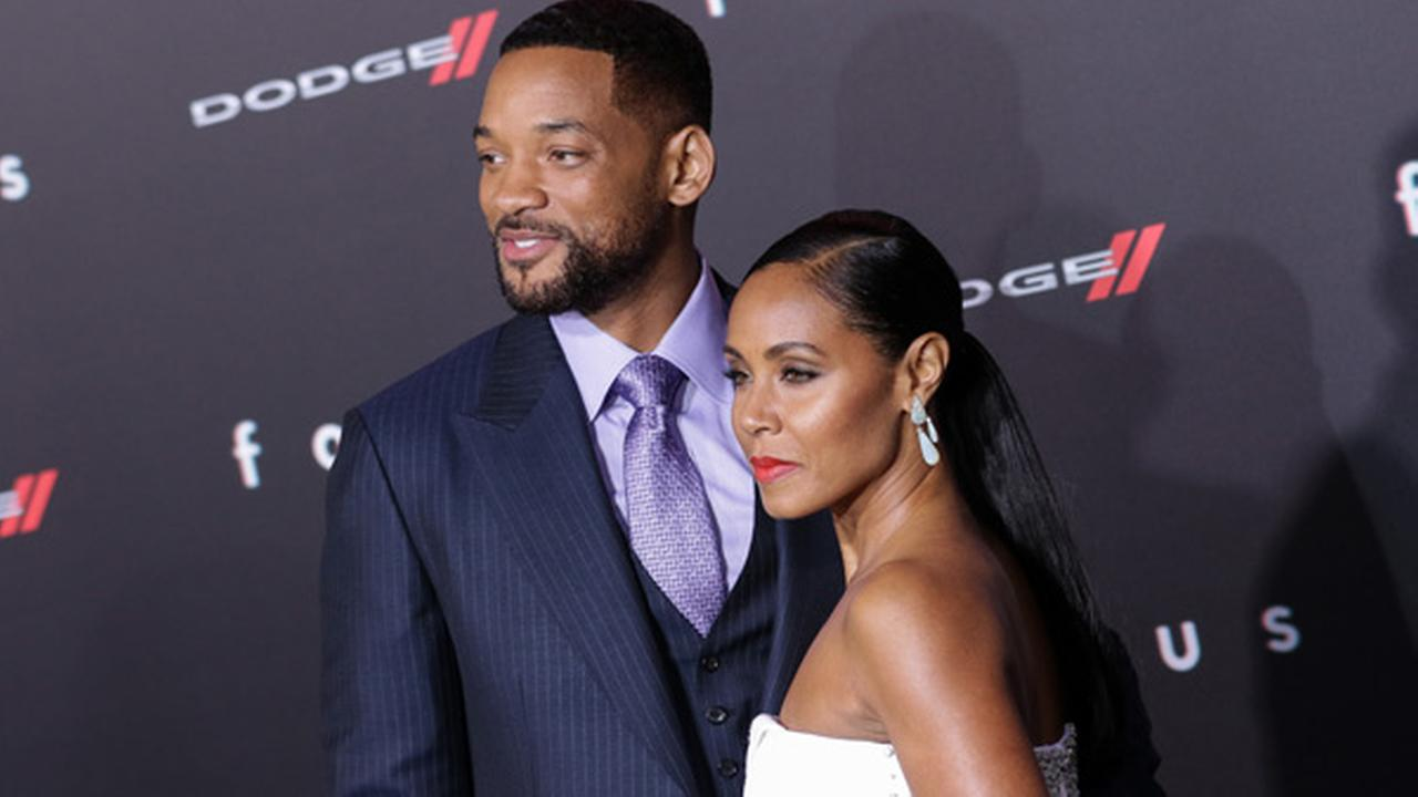Will Smith, left, and Jada Pinkett Smith arrive at the world premiere of Focus at the TCL Chinese Theatre on Tuesday, Feb. 24, 2015, in Los Angeles.