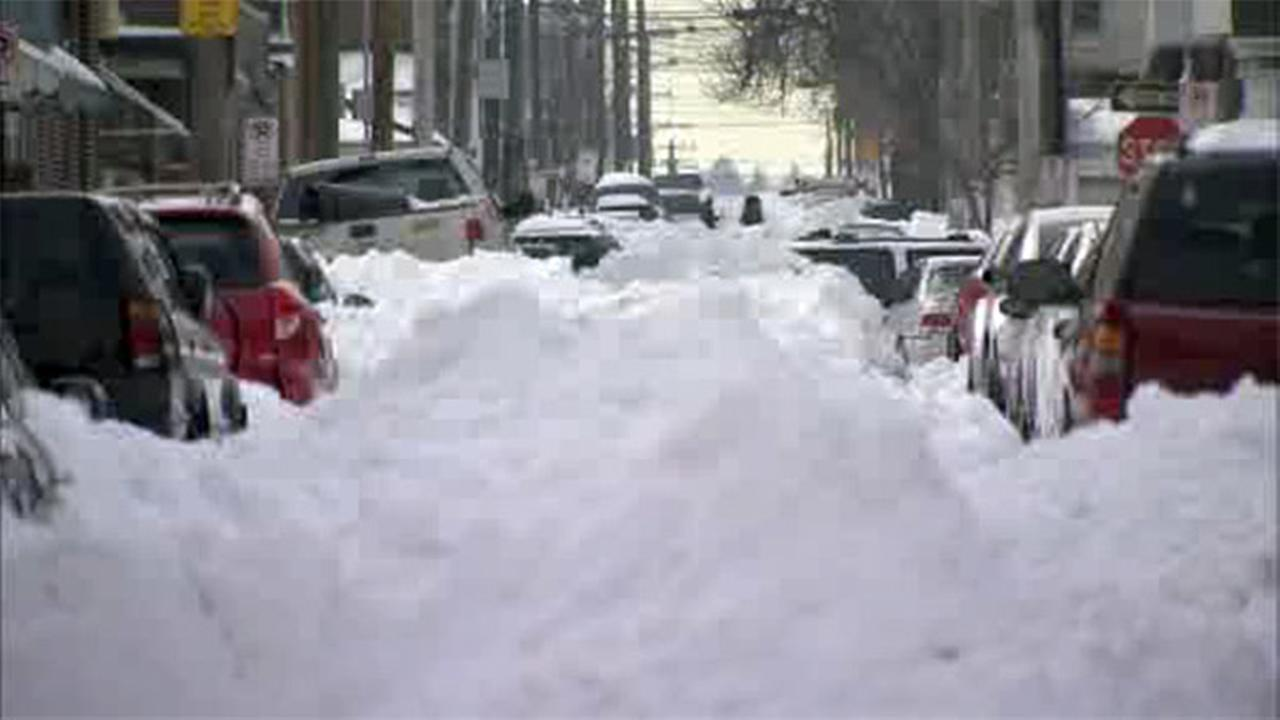 FILE - Mounds of snow cover a street in Allentown after a blizzard brought a record amount of snow to the region.