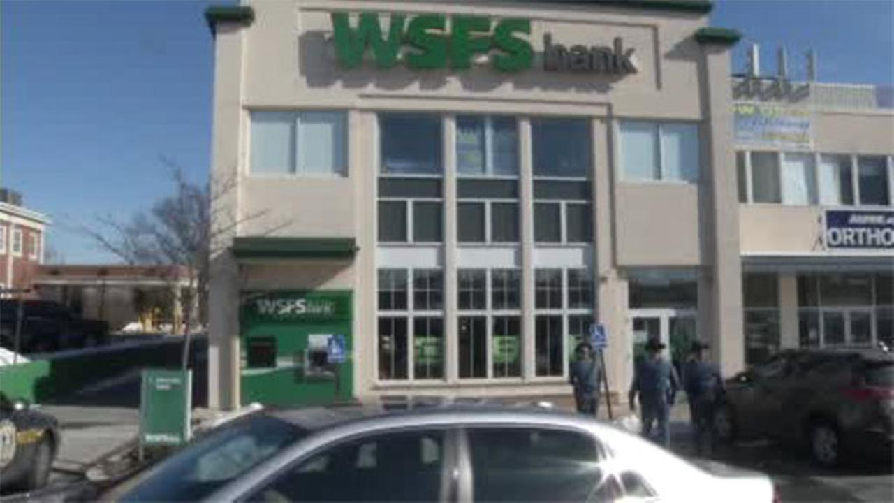Police are searching for a man wanted in connection with a robbery of a WSFS Bank in Wilmington.