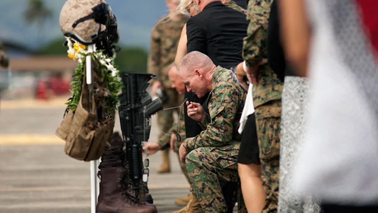 Family, friends and comrads pay their respects during a memorial service for the 12 U.S. Marines who died when their helicopters crashed off the North Shore of Oahu, Hawaii.