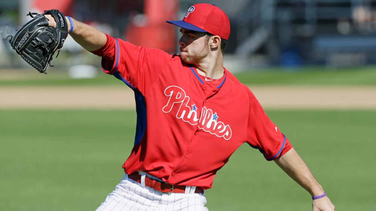 Philadelphia Phillies pitcher Jesse Biddle throws during spring training baseball practice Sunday, Feb. 16, 2014, in Clearwater, Fla.