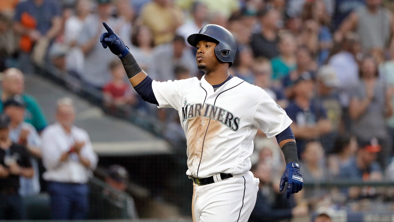 Seattle Mariners Jean Segura points skyward as he crosses home on his home run against the Houston Astros Tuesday, July 31, 2018, in Seattle.