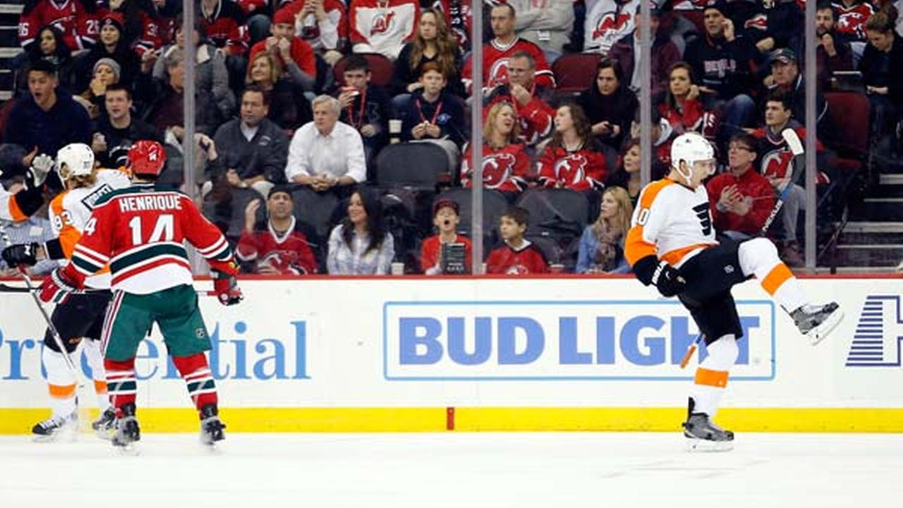 Philadelphia Flyers center Brayden Schenn, right, celebrates after scoring a goal against the New Jersey Devils during the second period of an NHL hockey game.