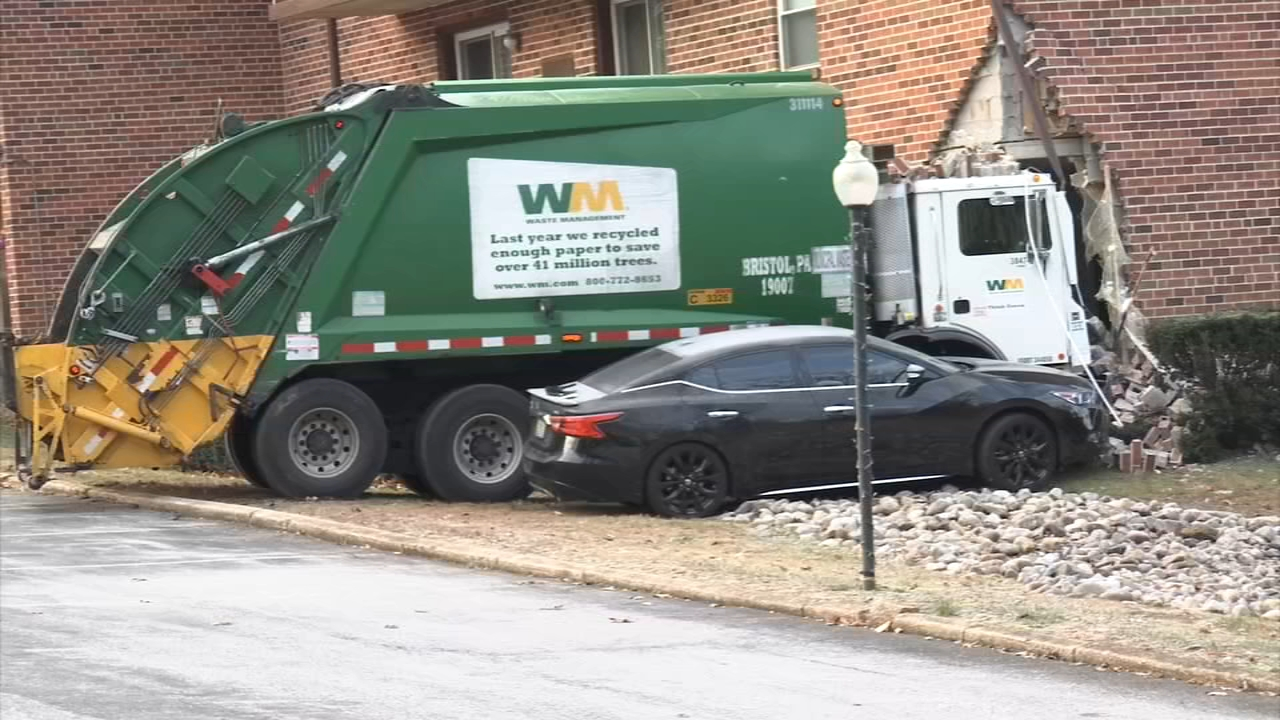 Trash truck crashes into side of apartment building in Havertown.
