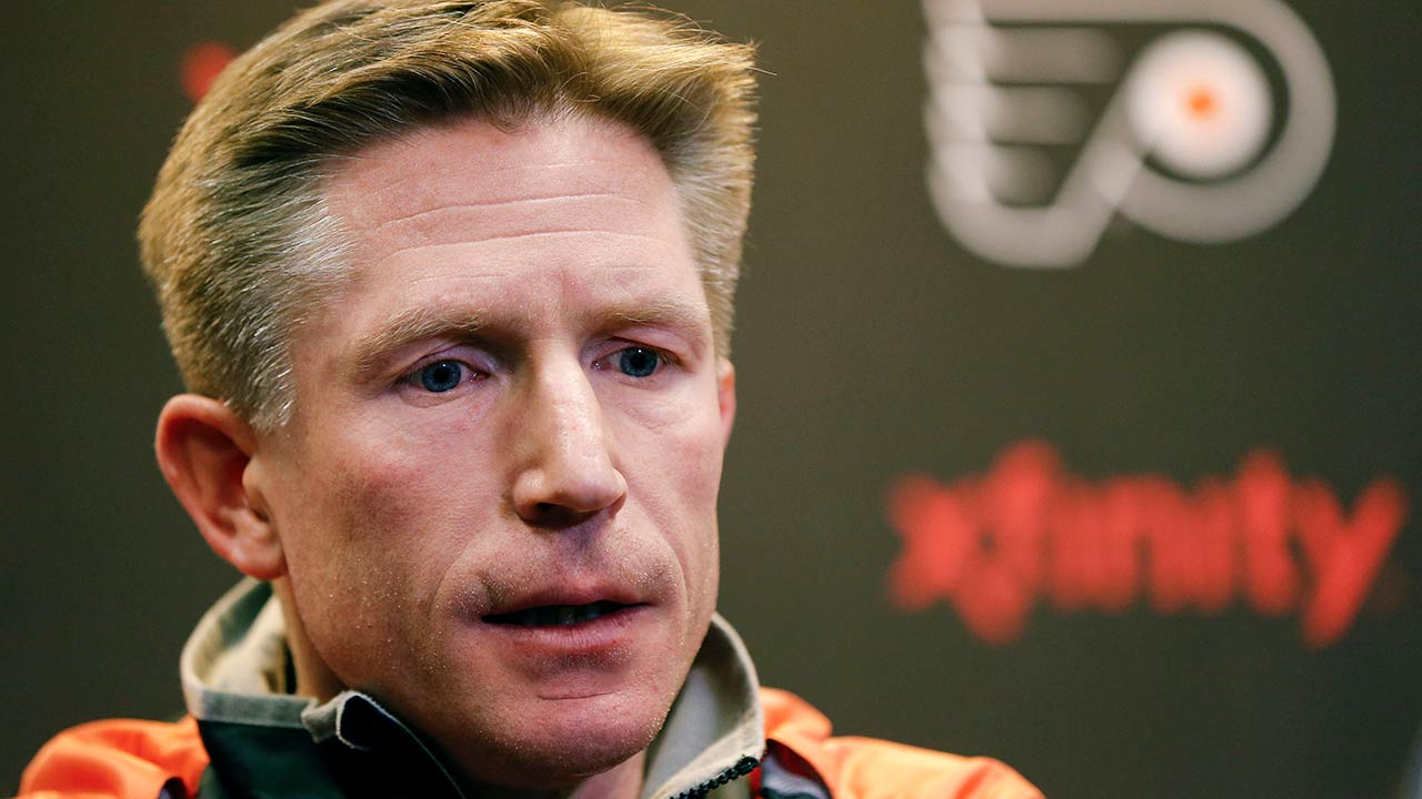 Philadelphia Flyers head coach Dave Hakstol speaks with members of the media during a news conference Monday, April 11, 2016, in Voorhees, N.J.