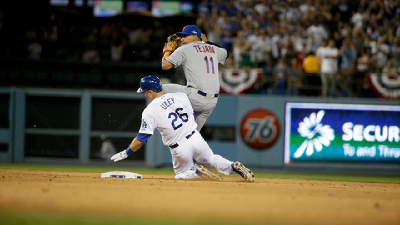 New York Mets shortstop Ruben Tejada, goes over the top of Los Angeles Dodgers Chase Utley who broke up a double play during the seventh inning in Game 2 of MLBs NLDS.