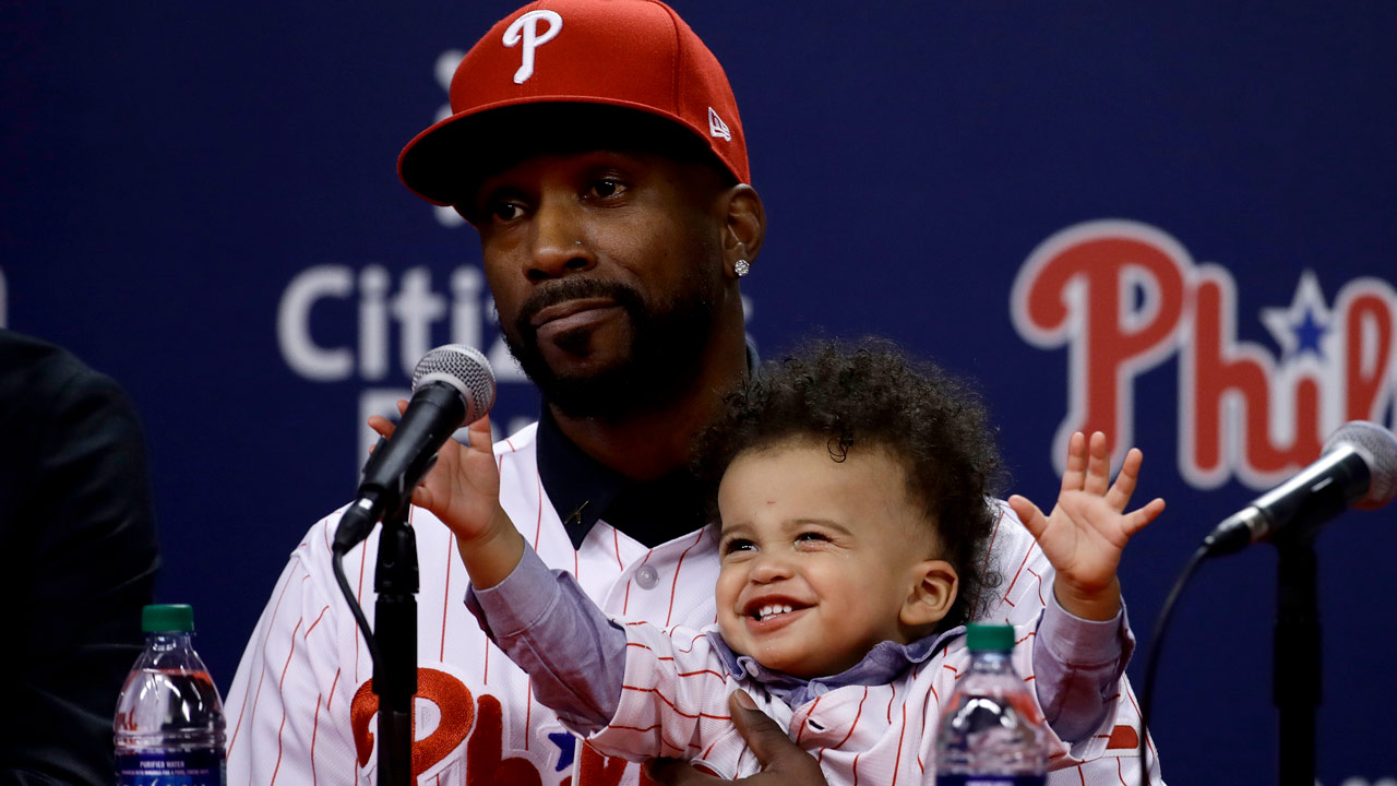 Philadelphia Phillies new outfielder Andrew McCutchen accompanied by his son Steel speaks during a news conference in Philadelphia, Tuesday, Dec. 18, 2018.