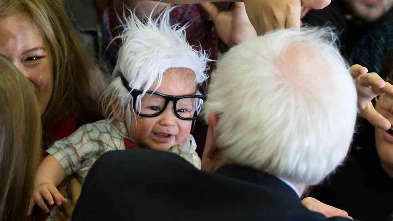 In this Sunday, Feb. 14, 2016 file photo, Democratic presidential candidate Sen. Bernie Sanders, I-Vt., right, meets 3-month-old Oliver Jack Carter Lomas-Davis, of Venice, Calif.