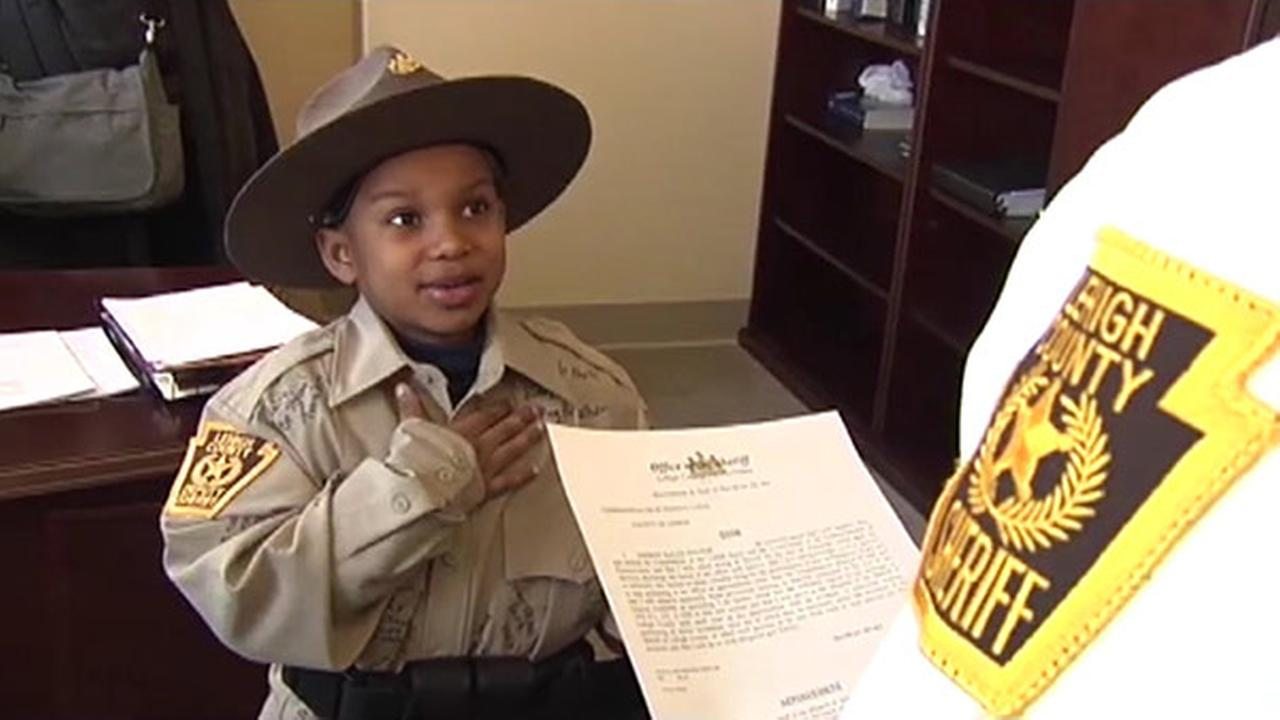 Boy battling rare disease made sheriff for the day
