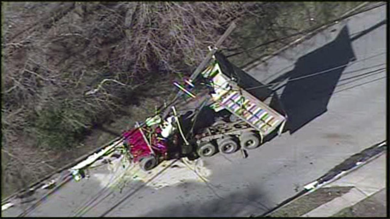 Dump truck hits utility pole, power out in part of Cherry Hill